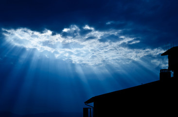 Light form the sky shining down on house / Jesus light