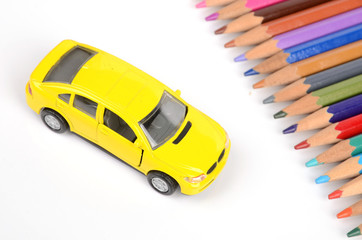 Color pencils and toy car