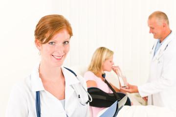 Medical doctors give drink patient broken arm