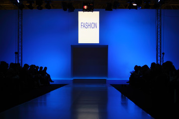 podium before showing new collection of clothing