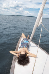 gril with closed eyes on yacht
