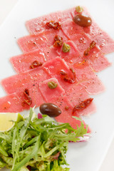 Fish Carpaccio with olives ana salad
