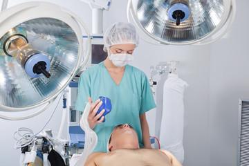 Doctor applying oxygen mask