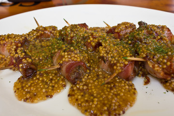 bacon rools with chicken liver under mustard sauce