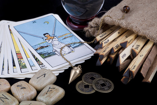 Various fortune telling techniques on a black background