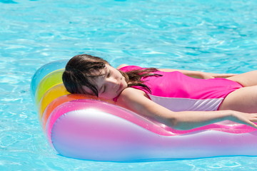 Girl floating on airbed