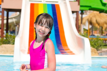 Happy young girl in pool