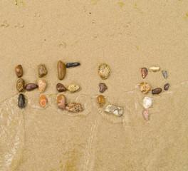 help written in pebbles on sea shore concept