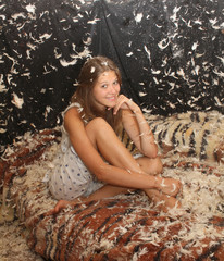 young beautiful girl in the feather