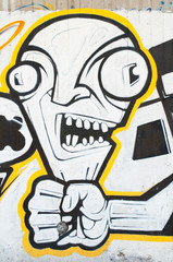 Hand squeezing head - abstract graffiti