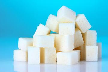 refined sugar on blue background