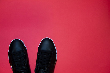 Trendy shoes on red background