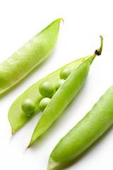 Fresh peas isolated on white background