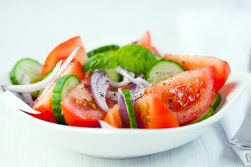 Tomato salad with cucumber and onion
