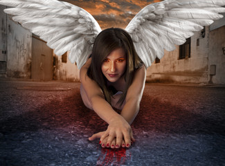 apocalyptic female angel lying in the street with bloody hands
