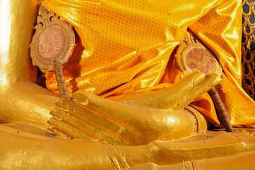 hand of golden buddha statue