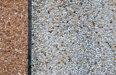 An image of a concrete wall covered by pebble dash.