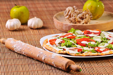 italian pizza with apples and garlic