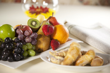 Fruit Plate with Croissants and newspapers