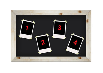 blank photo frames on blackboard isolated on white