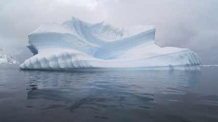 Fototapete - huge iceberg in atarctic ocean