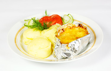 Baked Potato filled with meat and cheese on white plate