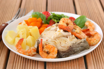 Boiled fish with shrimps and vegetables