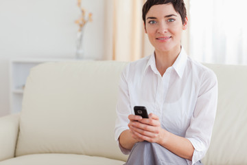 Portrait of a beautiful woman with a cellphone