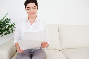 Charming woman with a paper