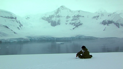 Wall Mural - tranquil figure sitting in antarctica