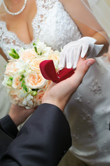 groom gives to bride a gold ring