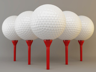 Group of golf  balls on tees