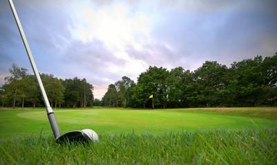 chipping golf ball onto green