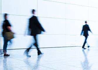 businessmen walking by