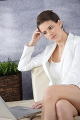 Attractive businesswoman in office lobby