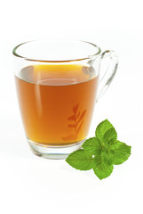 tea in glass cup with fresh mint leaves