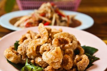 Crispy pork salted rind with thai herbal and papaya salad on the