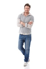 Confident man in jeans smiling
