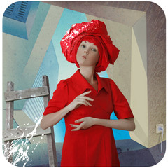 Funny girl in red dress standing in a room repaired