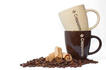 coffee beans, ceramic cups, cookies