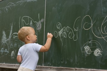 Boy drawing with chalk