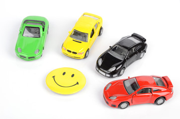 Toy cars and smiling face