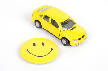 Toy car and smiling face