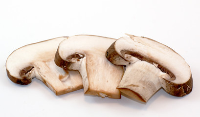 Three porcini mushroom slices on a white background.