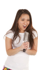 singing into a hair brush