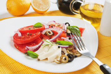 Caprese salad with mozzarella, tomato and basil