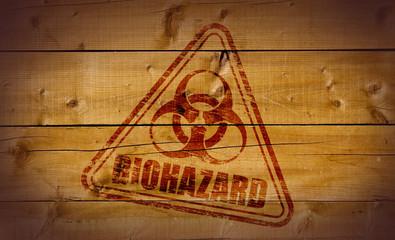 Biohazard stamp on wooden background