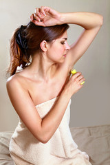 woman applying antiperspirant