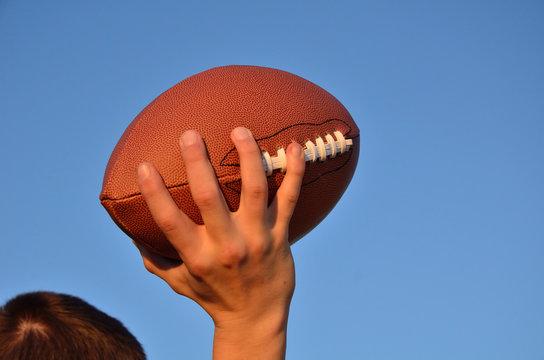 Quarterback Passing an American Football
