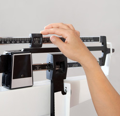 Woman on Weight Scale Closeup